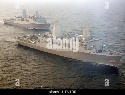 The USN San Antonio-class amphibious transport dock ships USS New York (back) and USS San Antonio steam in formation - Stock Photo