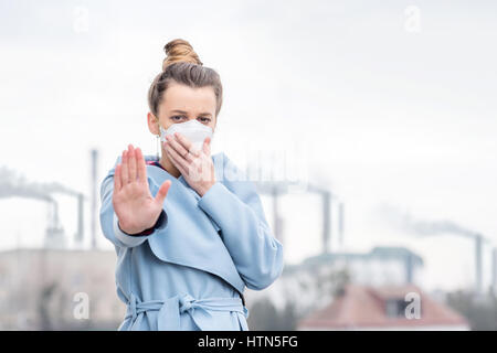 Woman with protective mask outdoors - Stock Photo