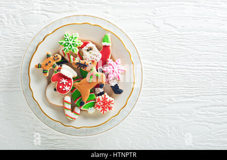 Delicious homemade christmas cookies plated on a white background. - Stock Photo