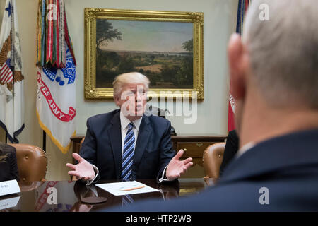 Washington DC, USA 13th March, 2017 US President Donald J Trump (Back) and US Vice President Mike Pence (Front) attend a meeting on healthcare in the Roosevelt Room of the White House in Washington, DC, USA, 13 March 2017 The House Republicans' bill known