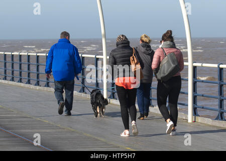 Southport, Merseyside, UK. UK Weather. 14th March, 2017. Bright, Breezy with Blue Skies for pier strollers. Barmy - Stock Photo