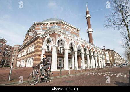 Amsterdam, Netherlands. 14th Mar, 2017. Daily Life - A man ride bicycle on the street in front of the West Mosque - Stock Photo
