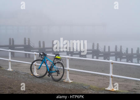 Aberystwyth, Wales, UK. 14th Mar, 2017. The seaside town is enveloped in a fog or sea-mist. n this photo a brightly - Stock Photo