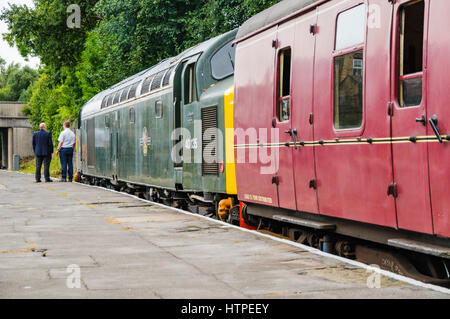 A 1960s recreated scene featuring a driver and secondman waiting for departure time woith their class 40 hauled - Stock Photo