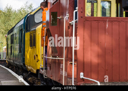 Driver and Guard waiting for the signal to depart with a demonstration freight train on the North Yorks Moors Railway - Stock Photo