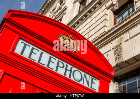 A red telephone box near Westminster, London, England - Stock Photo
