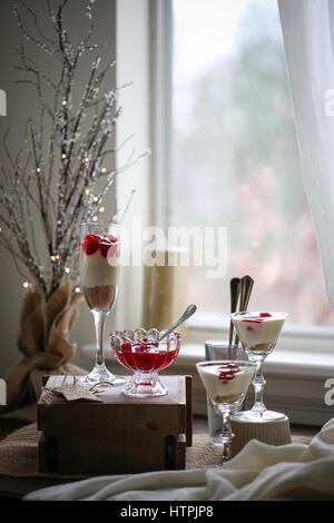 Cherry cheesecake shooters - Stock Photo