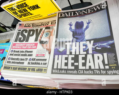 Headlines of New York tabloid newspapers on Wednesday, March 8, 2017 report on the release of documents on WikiLeaks - Stock Photo