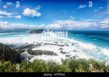 Heavy Seas with large waves and white spume at Minnamurra, Illawarra Coast, New South Wales, NSW, Australia - Stock Photo