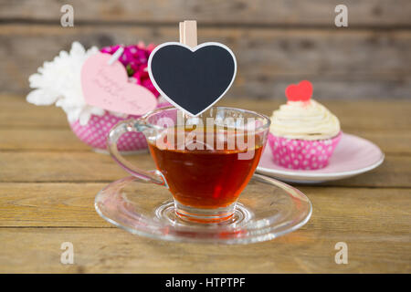 Cupcake Tea Flower Vase And Card In Tray On Wooden Plank Stock