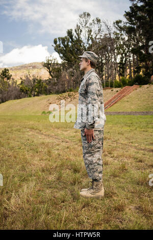 Military soldier standing at attention posture in boot camp - Stock Photo