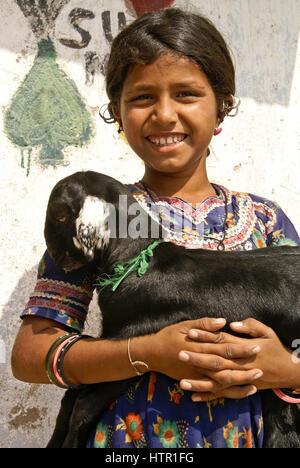 Meghwal Harijan girl with a little goat in a village near Bhuj, Gujarat, India - Stock Photo