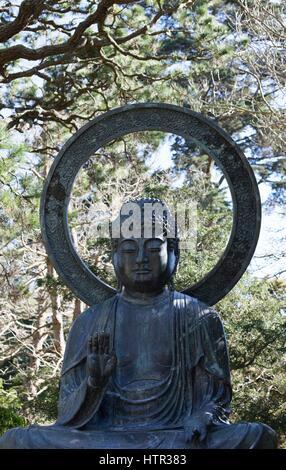 A Buddha statue at the Japanese Tea Garden in Golden Gate Park, San Francisco, California, USA. - Stock Photo