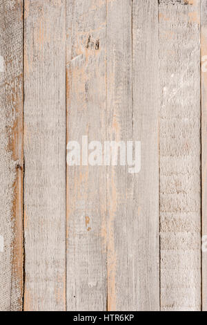 Wooden painted distressed panel made up of  vertical boards - Stock Photo