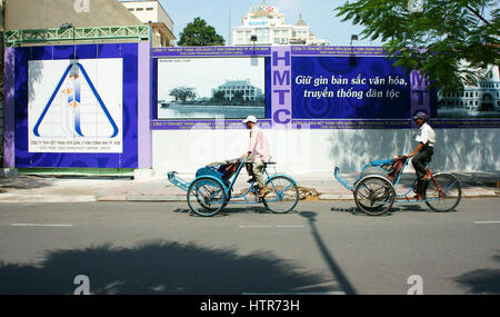 Ho Chi Minh city, Viet Nam, Asian man  on pedicab at  Saigon street, Vietnamese male earn money by cyclo driver, - Stock Photo