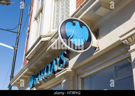 Barclays Bank sign on the branch in Llangollen Denbighshire, one of the few remaining banks maintaining a presence - Stock Photo