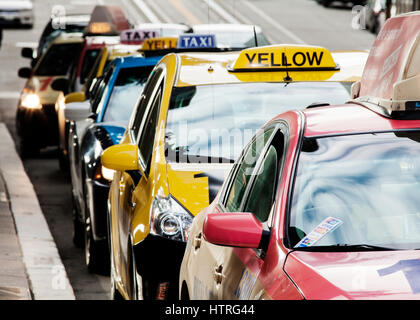 A row of colorful taxis. - Stock Photo