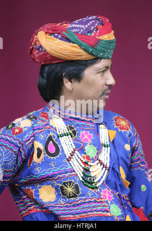 Indian man dressed in colourful costume and headdress.  Full frame. Portrait. - Stock Photo
