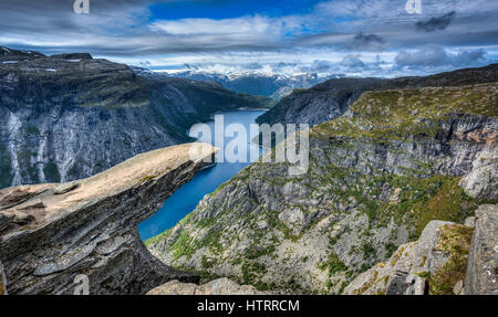 The amazing Trolltunga in Norway. Legend has it that a playful Troll wanted to test the legends and stuck his tongue - Stock Photo