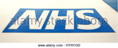 File photo dated 21/05/16 of an NHS logo. Patients are suffering in pain due to NHS rationing, which is affecting - Stock Photo