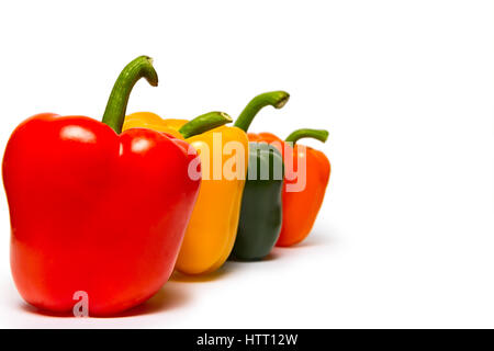 Red green and orange sweet bell peppers isolated on white background - Stock Photo