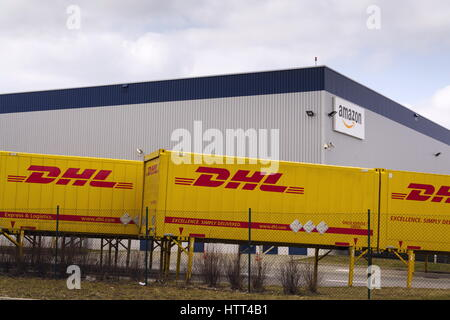 DOBROVIZ, CZECH REPUBLIC - MARCH 12: DHL shipping containers in front of Amazon logistics building on March 12, - Stock Photo