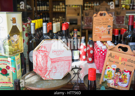 Ronda, Malaga Province, Andalusia, southern Spain. Display of typical foods and wine products in shop window. Cheese, - Stock Photo