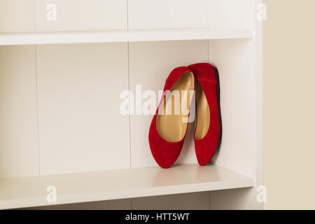 Womens shoes (flats) on the shelf in the closet. Selective focus. - Stock Photo