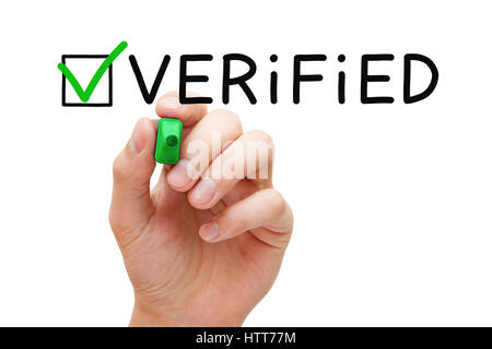 Hand putting check mark on Verified with green marker isolated on white. - Stock Photo