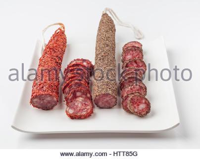Spanish sausage on white tray - Stock Photo