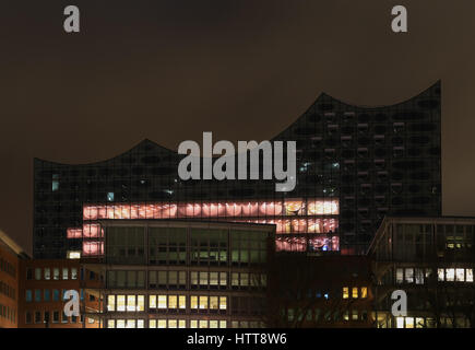 Hamburg, Germany - March 9, 2017: The elbe philharmonic hall in the harbor area Hafencity behind several office - Stock Photo