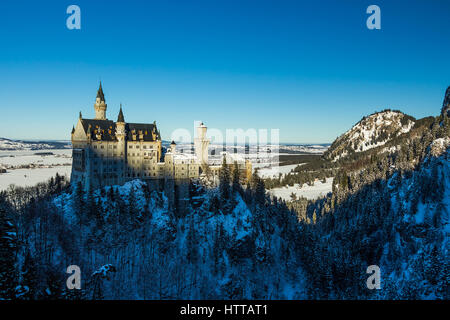 View of Neuschwanstein Castle in winter from Queen Mary's Bridge with snow - Stock Photo