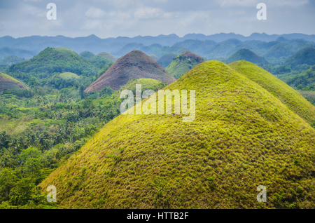 Chocolate hills in Bohol, some Clouds in Background, Philippines - Stock Photo