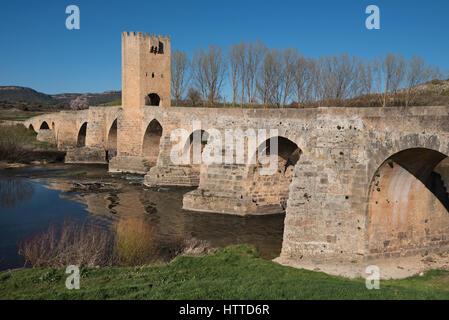 Medieval bridge over Ebro river in the ancient city of Frias, Burgos, Spain. - Stock Photo
