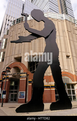 The Hammering Man kinetic sculpture by Jonathan Borofsky in front of the Seattle Art Museum building, Seattle, Washington, - Stock Photo