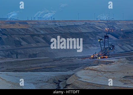Bucket-wheel excavator in the Garzweiler open-cast lignite mineat night Garzweiler, North Rhine-Westphalia, Germany, - Stock Photo