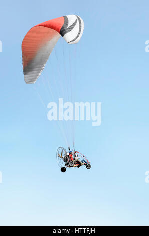 Spanish army soldier (C. VENTURY group), and his son, in paramotor, landing in Alcala de Henares, during an airshow - Stock Photo