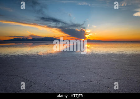 Sunset in Salar de Uyuni salt flats desert, Andes Altiplano, Bolivia - Stock Photo