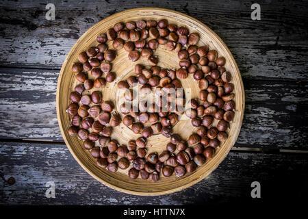 Hazelnuts on wood background - Stock Photo