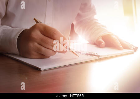 Concept of a businessman writing on a notebook. Image can be used for several purposes like: background, website - Stock Photo