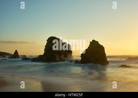 Sea stacks on Praia da Samonqueira, Porto Covo, Alentejo, Portugal. - Stock Photo