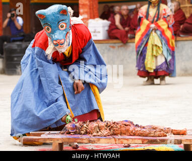 Lamayuru, India - June 17, 2012: Monk in mask performs sacrifice ritual on a religious masked and costumed Cham - Stock Photo