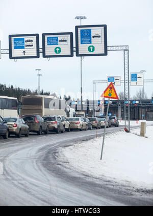 NUIJAMAA, FINLAND - CIRCA FEB, 2017: Road jam is on entry of Finnish–Russian border at the checkpoint in Finland - Stock Photo