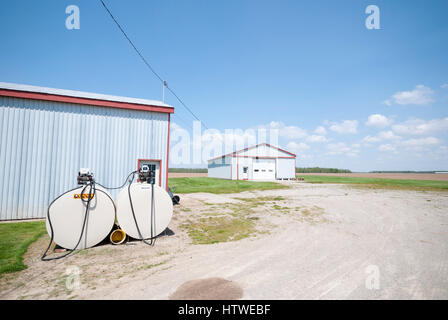 Gasboy fuel tanks and outbuildings on a corn farm in rural southern Ontario Canada. - Stock Photo