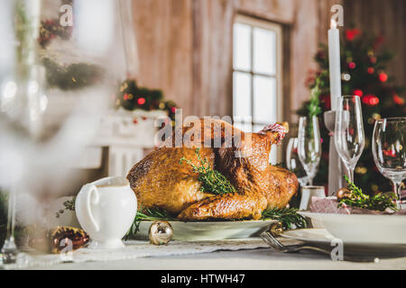 Delicious roasted turkey on served holiday table - Stock Photo