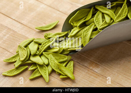 Green Italian spinach paste from Apulia shaped as olive leaves - Stock Photo