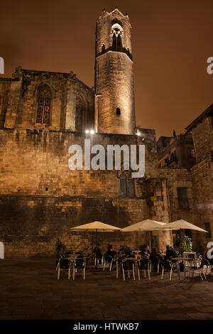 Tower of the Royal Chapel of St. Agatha and Placa del Rei square at night in Gothic Quarter (Barri Gotic) of Barcelona - Stock Photo