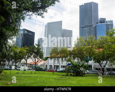 A contrast of modern high rise  towers and traditional shophouses in Singapore. - Stock Photo