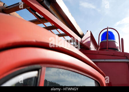 blue emergency vehicle lighting of a classic fire engine - Stock Photo