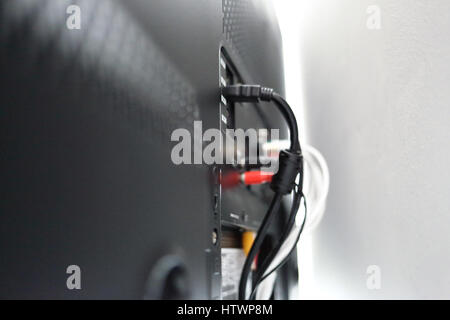 Various cables in the back of a LCD TV - Stock Photo